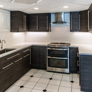 This is an example of a mid-sized contemporary u-shaped eat-in kitchen in Other with an undermount sink, flat-panel cabinets, dark wood cabinets, quartz benchtops, white splashback, porcelain splashback, stainless steel appliances, ceramic floors and no island.