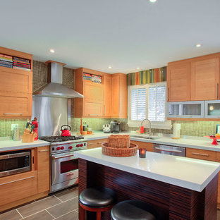 Contemporary kitchen photos - Trendy kitchen photo in Toronto with medium tone wood cabinets, green backsplash, mosaic tile backsplash and stainless steel appliances