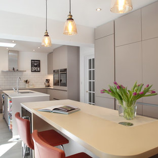 Contemporary handleless kitchen with two islands and breakfast bar