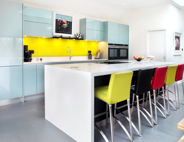 Contemporary high gloss kitchen with large island and bright bar stools