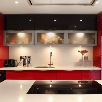 Contemporary high gloss red kitchen with frosted glass cabinets