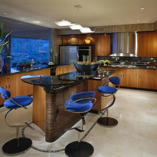 Large contemporary enclosed kitchen designs - Inspiration for a large contemporary u-shaped travertine floor and beige floor enclosed kitchen remodel in Phoenix with an undermount sink, flat-panel cabinets, medium tone wood cabinets, granite countertops, black backsplash, stone slab backsplash, stainless steel appliances, an island and black countertops