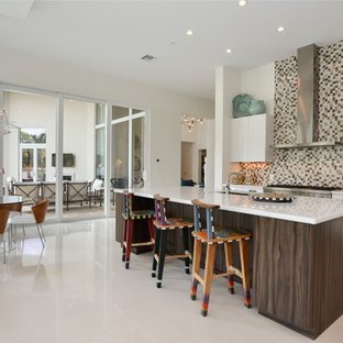 Mid-sized contemporary open concept kitchen photos - Example of a mid-sized trendy single-wall porcelain floor open concept kitchen design in Miami with an undermount sink, flat-panel cabinets, white cabinets, quartz countertops, mosaic tile backsplash, stainless steel appliances and an island