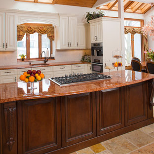 Design ideas for a large traditional eat-in kitchen in Bridgeport with an undermount sink, raised-panel cabinets, white splashback, stone tile splashback, panelled appliances, travertine floors, multiple islands, white cabinets, granite benchtops and orange benchtop.