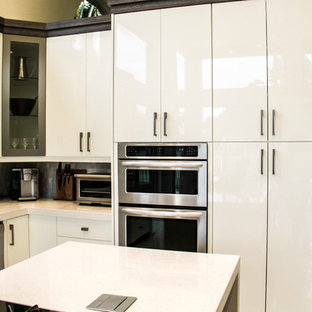 Design ideas for a mid-sized contemporary l-shaped eat-in kitchen in Miami with glass-front cabinets, white cabinets, grey splashback, an undermount sink, quartz benchtops, glass tile splashback, stainless steel appliances, marble floors, with island and beige floor.