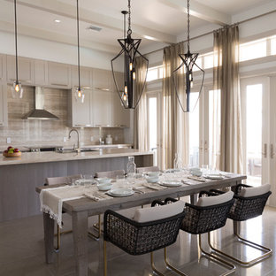 This is an example of a large contemporary l-shaped open plan kitchen in Miami with a submerged sink, shaker cabinets, grey cabinets, granite worktops, beige splashback, stone slab splashback, stainless steel appliances and an island.