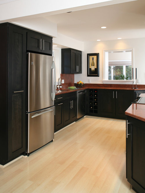 Kitchen with red backsplash and black cabinets design for Dark red kitchen cabinets
