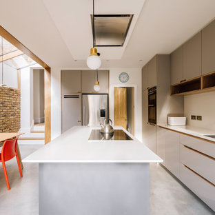 Photo of a medium sized contemporary galley kitchen/diner in Essex with an integrated sink, flat-panel cabinets, grey cabinets, an island, grey floors and white worktops.