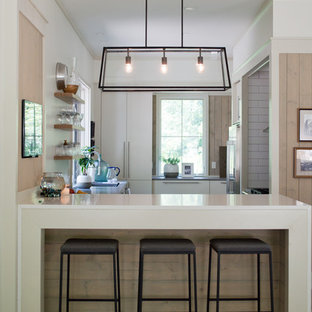 Mid-sized contemporary enclosed kitchen designs - Inspiration for a mid-sized contemporary u-shaped light wood floor and brown floor enclosed kitchen remodel in Other with open cabinets, light wood cabinets, a peninsula, quartz countertops, white backsplash, subway tile backsplash and stainless steel appliances