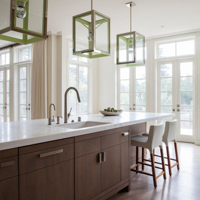 Kitchen - large contemporary medium tone wood floor and brown floor kitchen idea in San Francisco with an undermount sink, flat-panel cabinets, medium tone wood cabinets, an island and white countertops