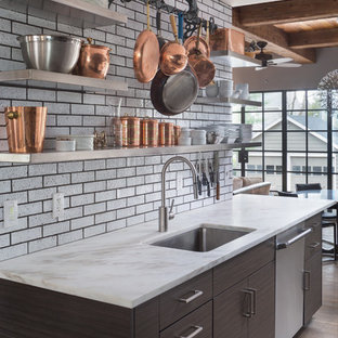 This is an example of a medium sized contemporary single-wall kitchen pantry in Other with flat-panel cabinets, brown cabinets, blue splashback, metro tiled splashback, stainless steel appliances and an island.