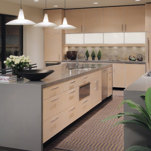 Example of a trendy kitchen design in Phoenix with flat-panel cabinets and gray backsplash