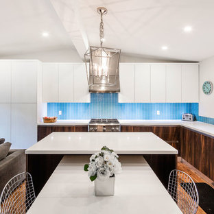 Inspiration for a large contemporary l-shaped eat-in kitchen in Toronto with an undermount sink, flat-panel cabinets, dark wood cabinets, blue splashback, stainless steel appliances, with island, dark hardwood floors, quartz benchtops, mosaic tile splashback and blue floor.