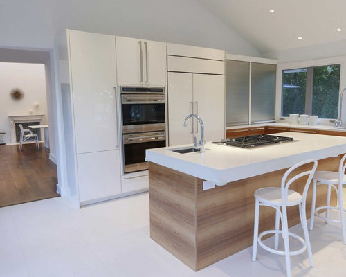 Contemporary L Shaped Kitchen Idea In New York With Flat Panel Cabinets,  White