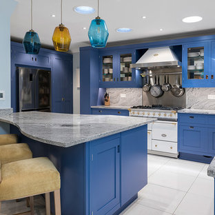Inspiration for a medium sized contemporary l-shaped kitchen in Hampshire with shaker cabinets, blue cabinets, granite worktops, grey splashback, white appliances, ceramic flooring, an island, white floors, grey worktops and a submerged sink.
