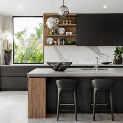 Example of a large trendy galley gray floor open concept kitchen design in Columbus with an undermount sink, flat-panel cabinets, black cabinets, quartzite countertops, white backsplash, marble backsplash, stainless steel appliances, an island and gray countertops
