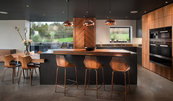 Contemporary kitchen diner: walnut, stainless steel, copper