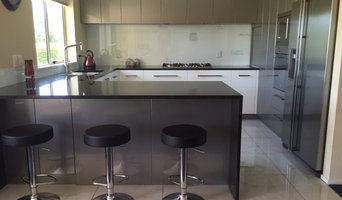 Contemporary kitchen featuring Black Pearl granite benches and two-tone gloss ca