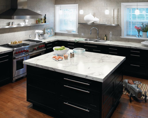 ... , stainless steel appliances, black cabinets and laminate countertops