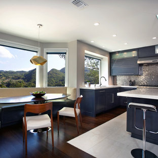 Design ideas for a contemporary eat-in kitchen in Orange County with shaker cabinets, black cabinets and metallic splashback.