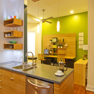 This is an example of a mid-sized contemporary eat-in kitchen in Chicago with an undermount sink, flat-panel cabinets, recycled glass benchtops, green splashback, glass tile splashback, stainless steel appliances and with island.