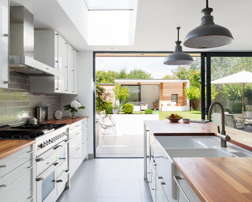 Mid Sized Trendy Galley Open Concept Kitchen Photo In London With A Farmhouse Sink