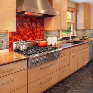 Kitchen - contemporary gray floor kitchen idea in Portland with stainless steel appliances, an undermount sink, flat-panel cabinets, medium tone wood cabinets, granite countertops, red backsplash and glass sheet backsplash