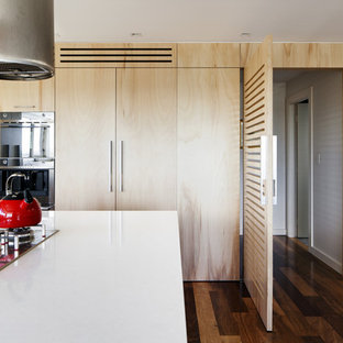 Contemporary kitchen in Sydney with flat-panel cabinets and light wood cabinets.