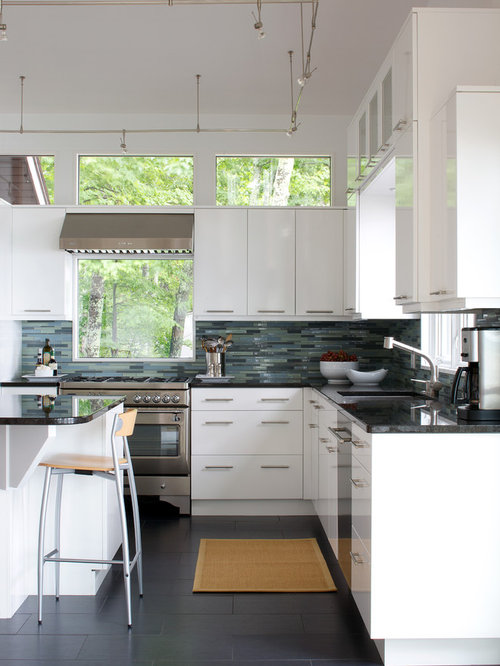 Example Of A Trendy L Shaped Kitchen Design In Other With Stainless Steel  Appliances,