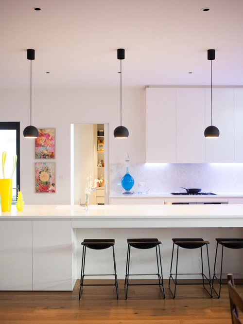 Trendy kitchen photo in Melbourne with an island & White Kitchen Pendant Light | Houzz azcodes.com