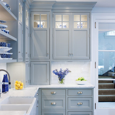 Inspiration for a large contemporary l-shaped dark wood floor enclosed kitchen remodel in New York with a farmhouse sink, beaded inset cabinets, gray cabinets, marble countertops, white backsplash, subway tile backsplash, stainless steel appliances and an island