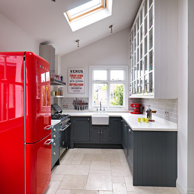 Kitchen - small transitional u-shaped kitchen idea in London with a farmhouse sink, shaker cabinets, gray cabinets, gray backsplash, subway tile backsplash and no island