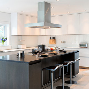Design ideas for a large contemporary l-shaped eat-in kitchen in New York with a single-bowl sink, flat-panel cabinets, white cabinets, marble benchtops, white splashback, glass sheet splashback, stainless steel appliances, ceramic floors and with island.
