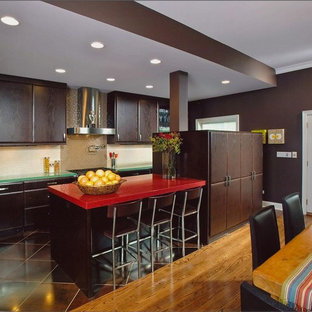 Design ideas for a large contemporary l-shaped eat-in kitchen in Chicago with stainless steel appliances, a drop-in sink, dark wood cabinets, glass benchtops, beige splashback, mosaic tile splashback, porcelain floors, with island, flat-panel cabinets and red benchtop.