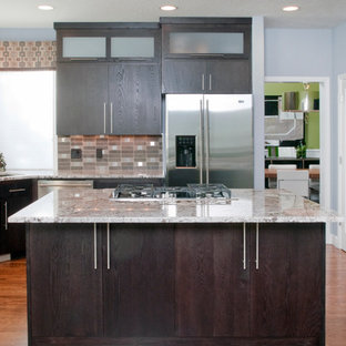 Contemporary open concept kitchen inspiration - Trendy u-shaped open concept kitchen photo in Other with flat-panel cabinets, stainless steel appliances, granite countertops, dark wood cabinets, an undermount sink, multicolored backsplash and mosaic tile backsplash