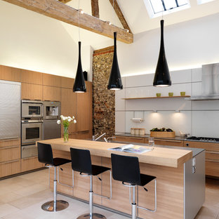Design ideas for a contemporary kitchen in Oxfordshire with flat-panel cabinets, medium wood cabinets and an island.