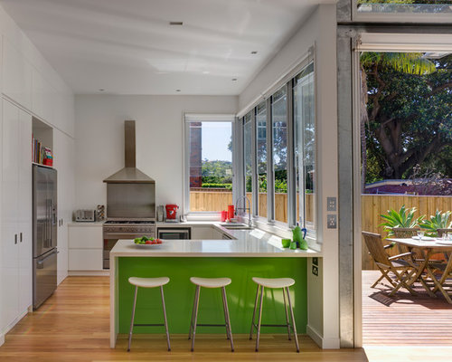 glass garage doors kitchen. Inspiration For A Contemporary U-shaped Open Plan Kitchen In Sydney With Double- Glass Garage Doors