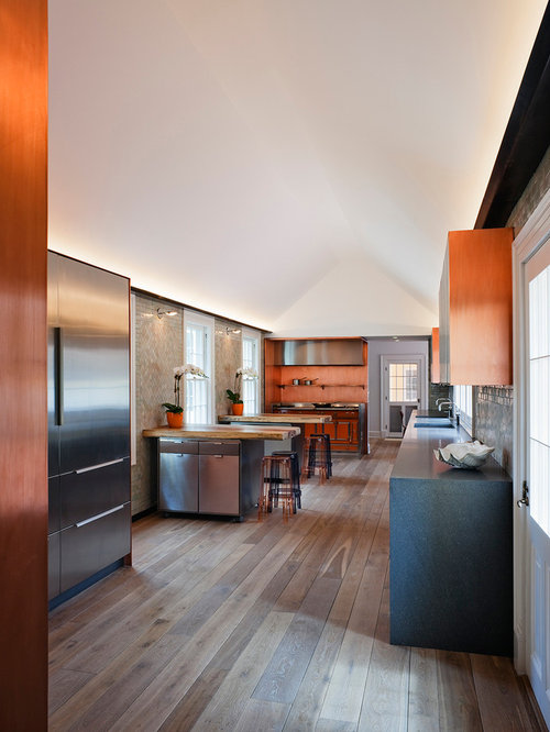 Inspiration For A Contemporary Kitchen Remodel In New York With Orange  Backsplash And Stainless Steel Appliances