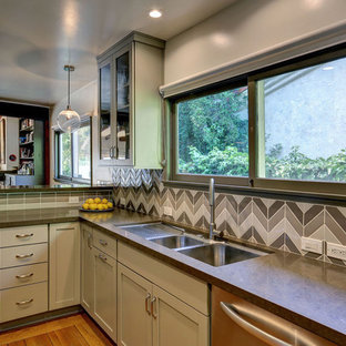 Example of a trendy kitchen design in Los Angeles with a double-bowl sink, shaker cabinets, gray cabinets, gray backsplash and stainless steel appliances