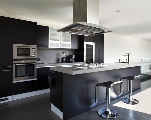 Example of a trendy galley concrete floor kitchen design in Other with  flat-panel cabinets