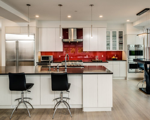 contemporary eat in kitchen pictures example of a trendy light wood floor and beige