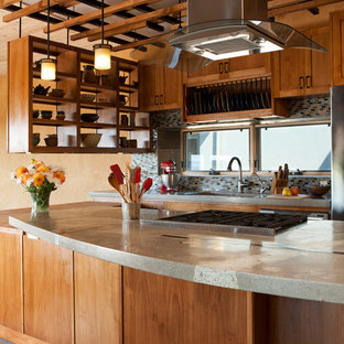 Southwestern kitchen inspiration - Example of a southwest kitchen design in Albuquerque with mosaic tile backsplash, concrete countertops, open cabinets, medium tone wood cabinets and multicolored backsplash
