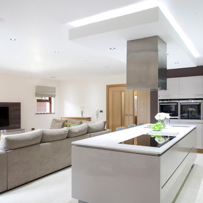 Open concept kitchen - contemporary open concept kitchen idea in Belfast with an undermount sink, flat-panel cabinets and white cabinets