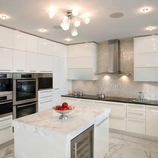 Contemporary kitchen inspiration - Kitchen - contemporary kitchen idea in Miami with flat-panel cabinets, marble countertops, white backsplash, glass tile backsplash and black countertops