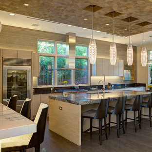 Contemporary kitchen inspiration - Example of a trendy kitchen design in Dallas with flat-panel cabinets, light wood cabinets, beige backsplash and stainless steel appliances