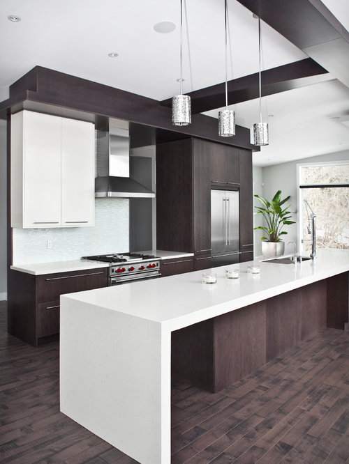 Minimalist Kitchen Photo In Burlington With Flat Panel Cabinets Stainless Steel Appliances And An