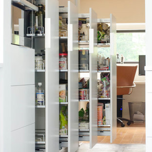 Large contemporary kitchen pantry designs - Kitchen pantry - large contemporary porcelain tile kitchen pantry idea in Kansas City with flat-panel cabinets, white cabinets and stainless steel appliances
