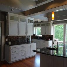 Contemporary Kitchen by Straightline Design, Inc.
