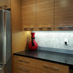 Contemporary kitchen remodeling - Example of a trendy porcelain tile kitchen design in Seattle with an undermount sink, flat-panel cabinets, quartz countertops, multicolored backsplash and glass tile backsplash