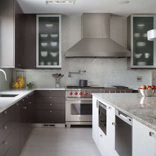 Photo of a large contemporary l-shaped kitchen in Other with flat-panel cabinets, an undermount sink, quartz benchtops, metallic splashback, stainless steel appliances, ceramic floors, metal splashback and dark wood cabinets.